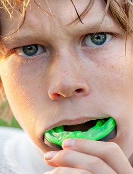 A young boy wears a mouthguard in Murphy to protect his teeth while on the field