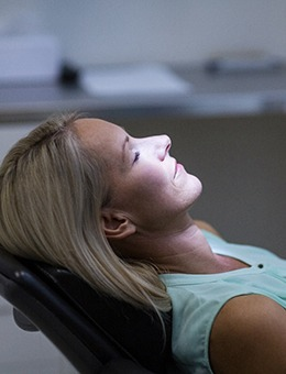 Woman relaxing while visiting her Murphy sedation dentist