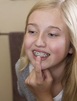 young girl checking braces