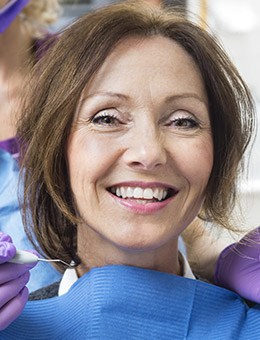 woman smiling with dental bib on