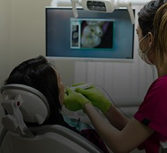 Dentist and patient looking at intraoral images on computer