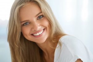 woman blonde hair beautiful smile